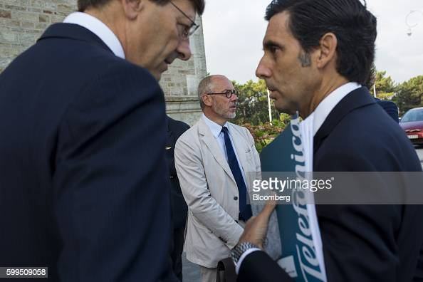 Vittorio Colao chief executive officer of Vodafone Group Plc left speaks with Jose Maria AlvarezPallete chairman and chief executive officer of...
