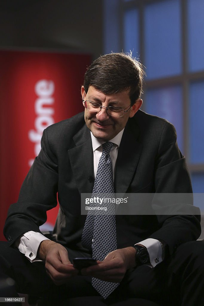 Vittorio Colao, chief executive officer of Vodafone Group Plc, looks at his mobile phone ahead of a Bloomberg Television interview in London, U.K., on Tuesday, Nov. 13, 2012. Vodafone Group Plc, the second-largest mobile-phone company, reported service revenue that missed analysts' estimates and took a 5.9 billion pound ($9.4 billion) impairment writedown in Spain and Italy. Photographer: Simon Dawson/Bloomberg via Getty Images
