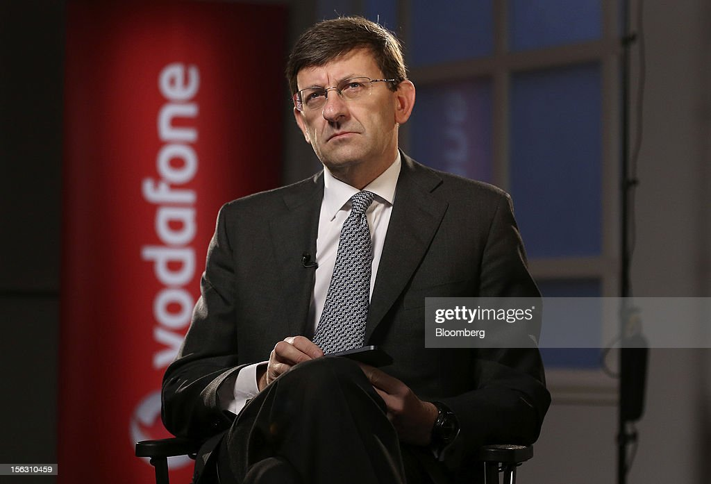 Vittorio Colao, chief executive officer of Vodafone Group Plc, reacts during a Bloomberg Television interview in London, U.K., on Tuesday, Nov. 13, 2012. Vodafone Group Plc, the second-largest mobile-phone company, reported service revenue that missed analysts' estimates and took a 5.9 billion pound ($9.4 billion) impairment writedown in Spain and Italy. Photographer: Simon Dawson/Bloomberg via Getty Images