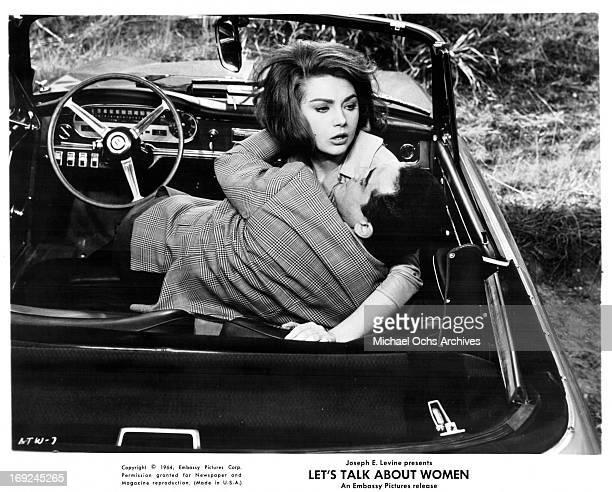 Vittorio Gassman grabs onto Sylva Koscina in a scene from the film 'Let's Talk About Women' 1964