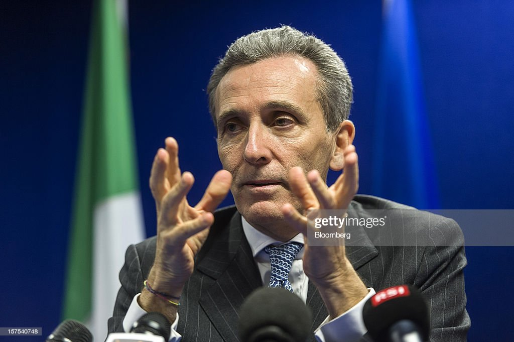 Vittorio Grilli, Italy's finance minister, gestures during a news conference following the European Union (EU) finance ministers meeting at the European Council headquarters in Brussels, Belgium, on Tuesday, Dec. 4, 2012. European Union finance ministers tried to bridge bank oversight disagreements, a step that would help sever links between banking woes and sovereign debt plaguing the crisis-stricken euro zone. Photographer: Jock Fistick/Bloomberg via Getty Images