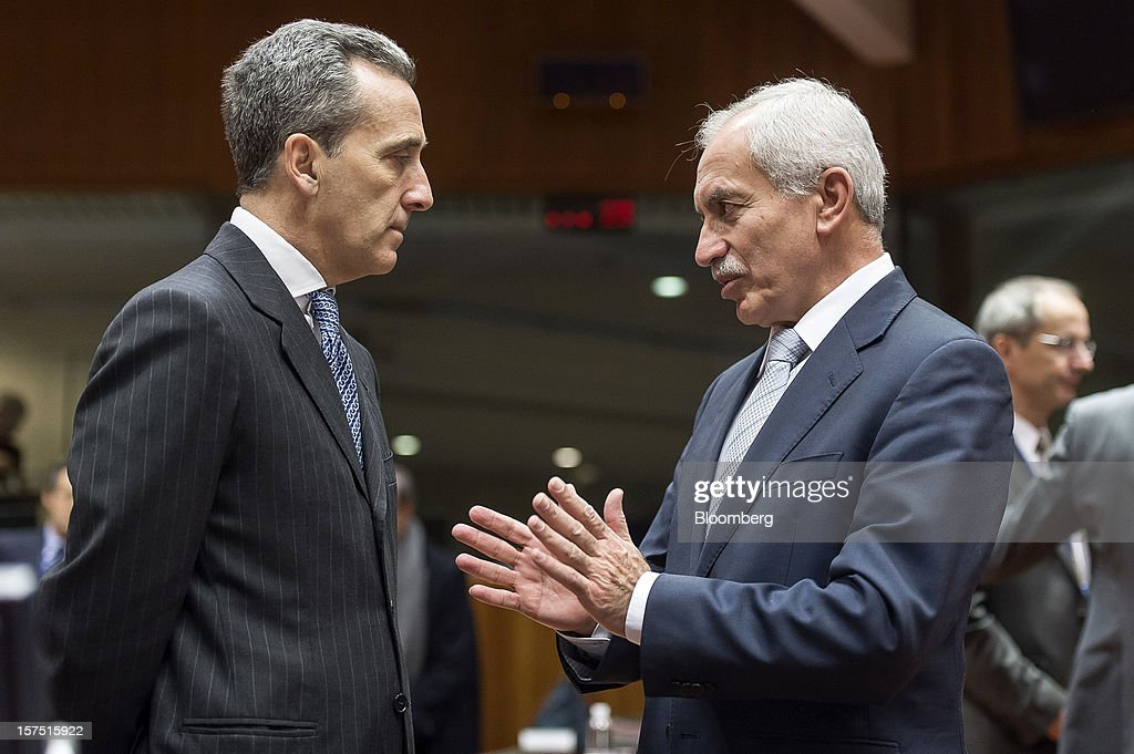 Vittorio Grilli, Italy's finance minister, left, speaks with Vassos Shiarly, Cyprus' finance minister, during a meeting of European Union (EU) finance ministers at the European Council headquarters in Brussels, Belgium, on Tuesday, Dec. 4, 2012. European finance ministers voiced confidence that Greece will pull off a successful bond buyback, the key element in a revamped effort to stem the debt crisis in the country where it started. Photographer: Jock Fistick/Bloomberg via Getty Images