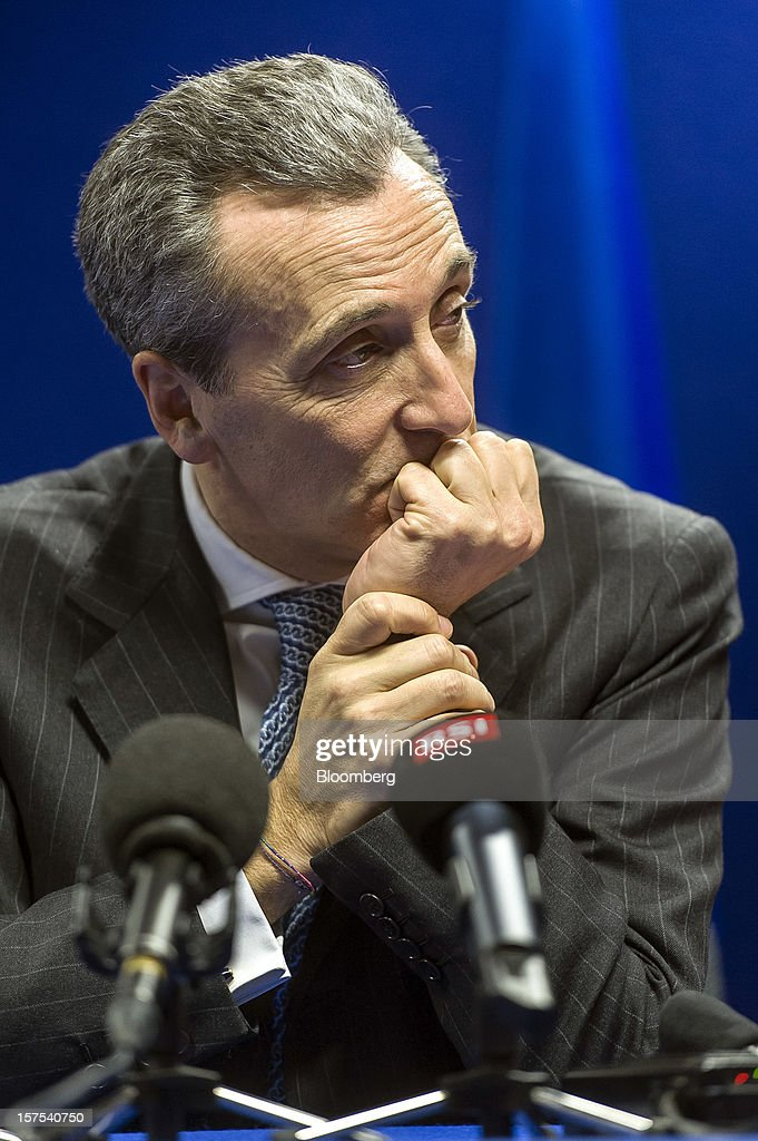 Vittorio Grilli, Italy's finance minister, pauses during a news conference following the European Union (EU) finance ministers meeting at the European Council headquarters in Brussels, Belgium, on Tuesday, Dec. 4, 2012. European Union finance ministers tried to bridge bank oversight disagreements, a step that would help sever links between banking woes and sovereign debt plaguing the crisis-stricken euro zone. Photographer: Jock Fistick/Bloomberg via Getty Images