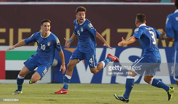 Vittorio Parigini of Italy celebrates scoring a goal during the Group B FIFA U17 World Cup match between Italy and Uruguay at Ras Al Khaimah Stadium...