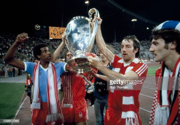 Viv Anderson and Frank Clark of Nottingham Forest parade the trophy after their 10 victory over Malmo in the European Cup Final at the Olympic...