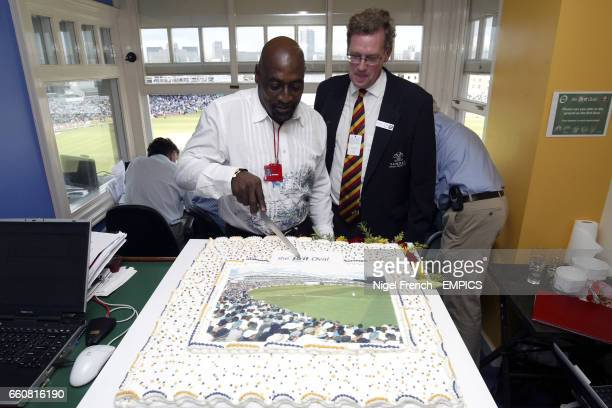 Viv Richards cuts the cake in the design of the new Brit Oval in front of Paul Sheldon Chief Executive of Surrey CCC