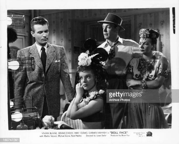 Vivian Blaine and Carmen Miranda with two unknown actors in a scene from the film 'Doll Face' 1945