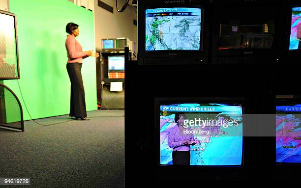Vivian Brown an onair meteorologist with the Weather Channel appears on a monitor right during a broadcast from the Weather Channel studios in...