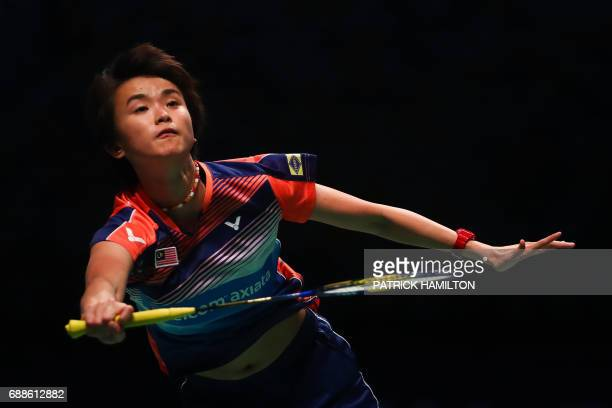 Vivian Hoo of Malaysia hits a return during her women's doubles Sudirman Cup match with partner Woon Khe Wei against Japan's Misaki Matsutomo and...