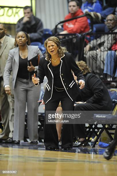 C Vivian Stringer head coach of Rutgers Scarlet Knights argues a call during a women's college basketball game against the George Washington...