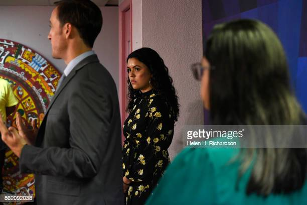 DENVER CO OCTOBER 16 Viviana Andazola Marquez middle listens while her attorney Hans Meyer of Meyer Law Office left speaks to members of the press at...