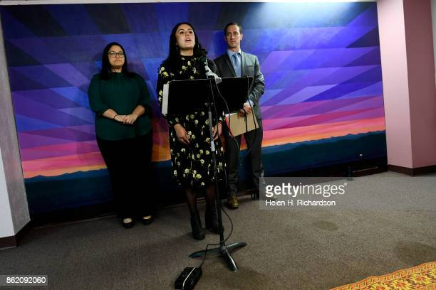 DENVER CO OCTOBER 16 Viviana Andazola Marquez with her attorney Hans Meyer of Meyer Law Office right back and policy director Julie Gonzales left...