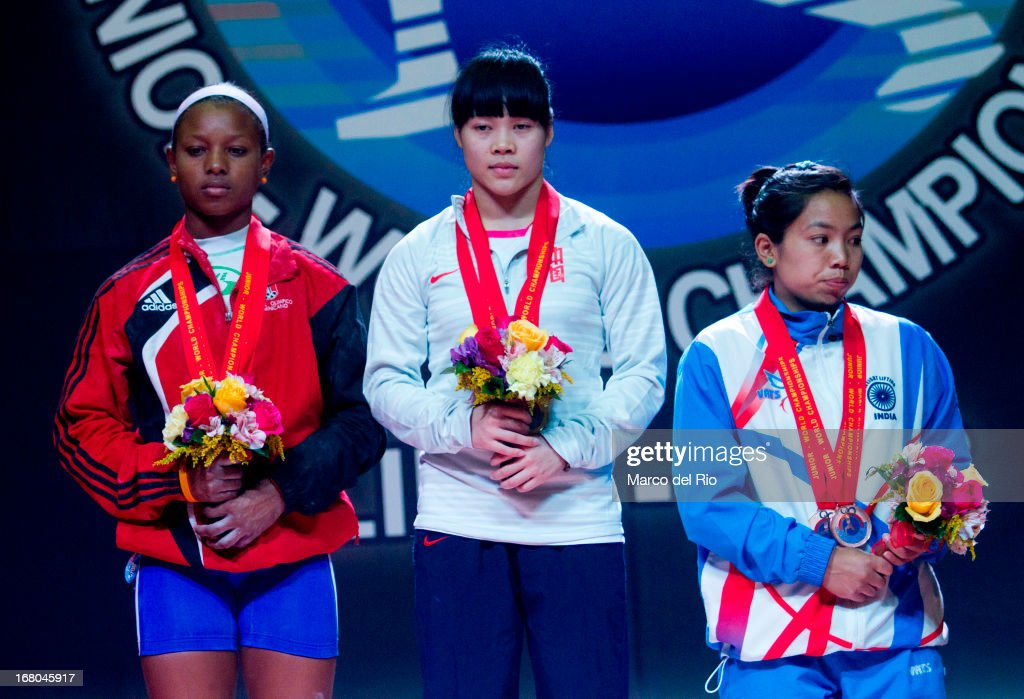 Viviana Munoz of Domincan Republic A (L), Chunying Guan of China A (C) and Mirabai Chanu Saikhom of India A (R) stand in the podium in the Women's 48kg awards ceremony during day one of the 2013 Junior Weightlifting World Championship at Maria Angola Convention Center on April 04, 2013 in Lima, Peru.