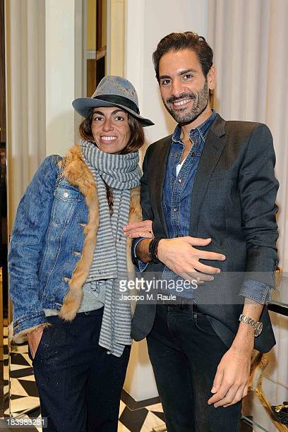 Viviana Volpicella and Angelo Ruggeri attend Sergio Rossi Boutique Inauguration In Montenapoleone on October 10 2013 in Milan Italy
