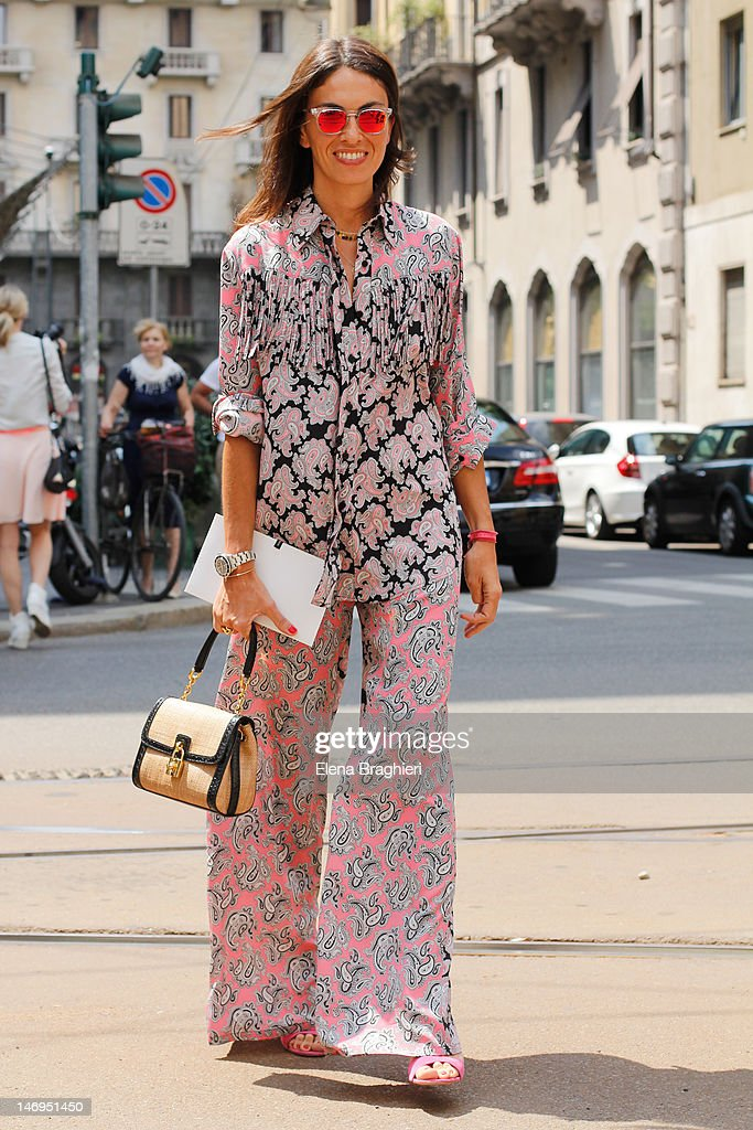 Viviana Volpicella attends Milan Fashion Week Menswear Spring/Summer 2013 on June 23 2012 in Milan Italy She's wearing a MSGM total look and a Dolce...