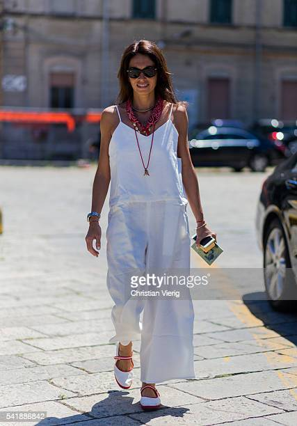 Viviana Volpicella wearing a white overall outside Gucci during the Milan Men's Fashion Week Spring/Summer 2017 on June 20 2016 in Milan Italy