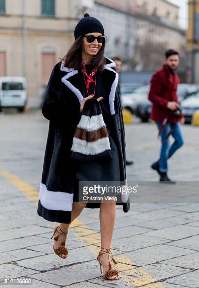 Viviana Volpicella weark a black fur coat and bag seen outside Gucci during Milan Fashion Week Fall/Winter 2016/17 on February 24 2016 in Milan Italy