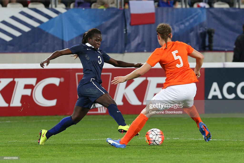 Viviane Asseyi #3 of France tries to control the ball against Dominique Janssen #5 of Netherlands during the international friendly game between France and Netherlands at Stade Jean Bouin on October 23, 2015 in Paris, France.