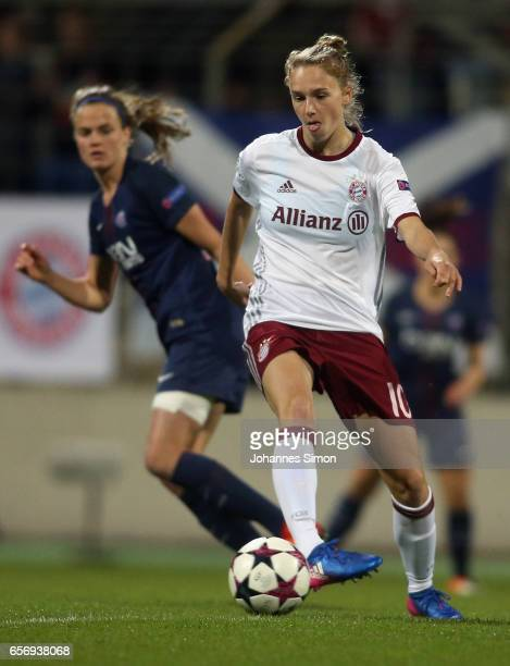 Vivianne Miedema of Bayern fights for the ball with Irene Paredes of Paris St Germain during the UEFA women's champions league quarter finals at...