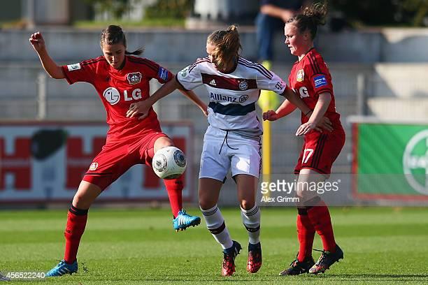 Vivianne Miedema of Muenchen is challenged by Valeria Kleiner and Marina Hegering of Leverkusen during the Allianz FrauenBundesliga match between...