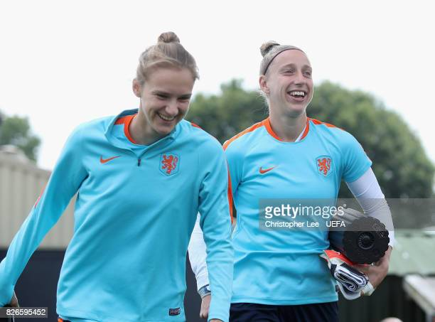 Vivianne Miedema of the Netherlands and Sari van Veenendaal of the Netherlands joke around as they walk to training during the Netherlands Training...