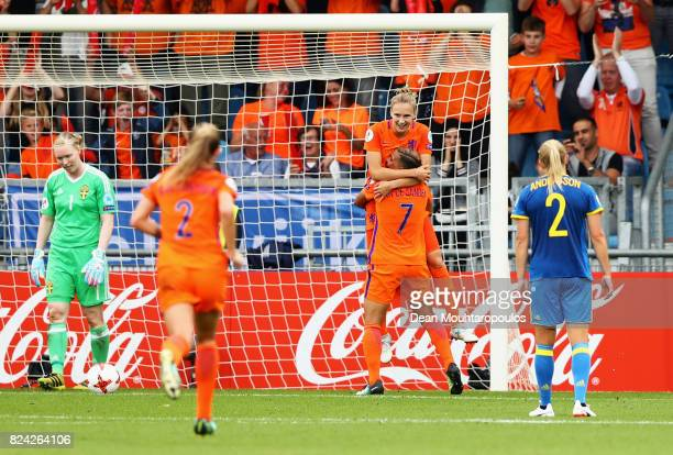 Vivianne Miedema of the Netherlands celebrates scoring her team's second goal with Shanice van de Sanden of the Netherlands during the UEFA Women's...