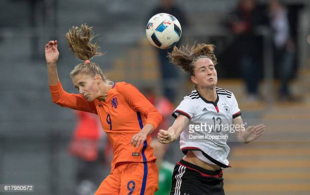 Vivianne Miedema of the Netherlands jumps for a header with Sara Daebritz of Germany during the Women's International Friendly match between Germany...