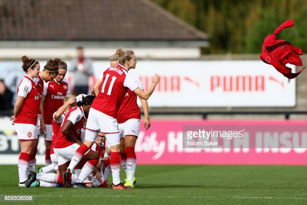 Vivianne Miedema throws her jacket to kit staff in preperation for the team photo prior to the Women's Super League 1 match between Arsenal and...