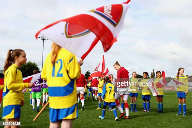 Vivianne Miedema walks out with a mascot prior to the Women's Super League 1 match between Arsenal and Bristol City at Meadow Park Boreham Wood on...