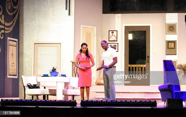 Vivica A Fox and Brian Mcknight perform during the Je'Caryous Johnson stage play 'Cheaper to Keep Her' at James L Knight Center on February 18 2011...