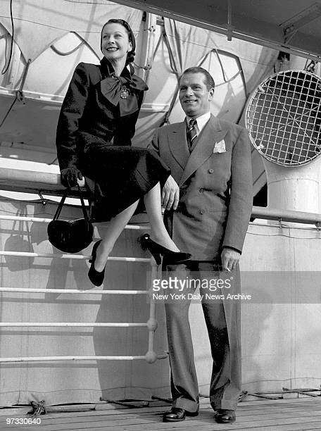 Vivien Leigh and husband Laurence Olivier get view of New York skyline from Mauretania's deck on arrival from England They're to appear in Olivier's...