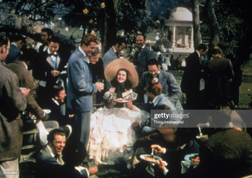 Vivien Leigh as Scarlett O'Hara is surrounded by her beaux in an early scene from the MGM film 'Gone with the Wind'.