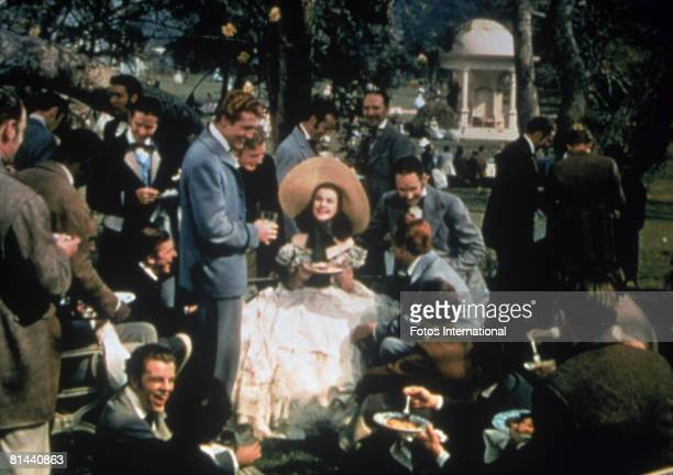 Vivien Leigh as Scarlett O'Hara is surrounded by her beaux in an early scene from the MGM film 'Gone with the Wind'
