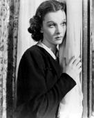Vivien Leigh British actress wearing a dark jacket posing beside a white curtain in a studio portrait circa 1940