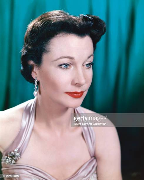Vivien Leigh British actress wearing a lilac silk halterneck top in a studio portrait against a blue curtain circa 1940