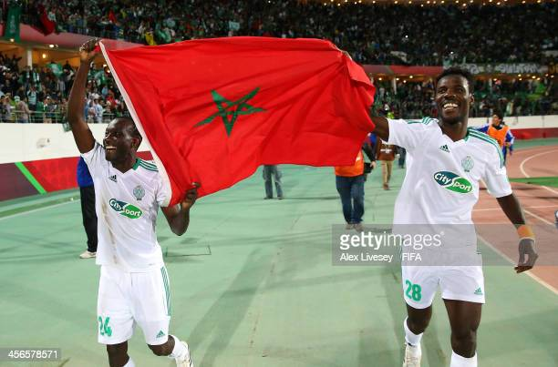Vivien Mabide and Kouko Guehi of Raja Casablanca celebrate victory over CF Monterrey after the FIFA Club World Cup Quarter Final match between Raja...