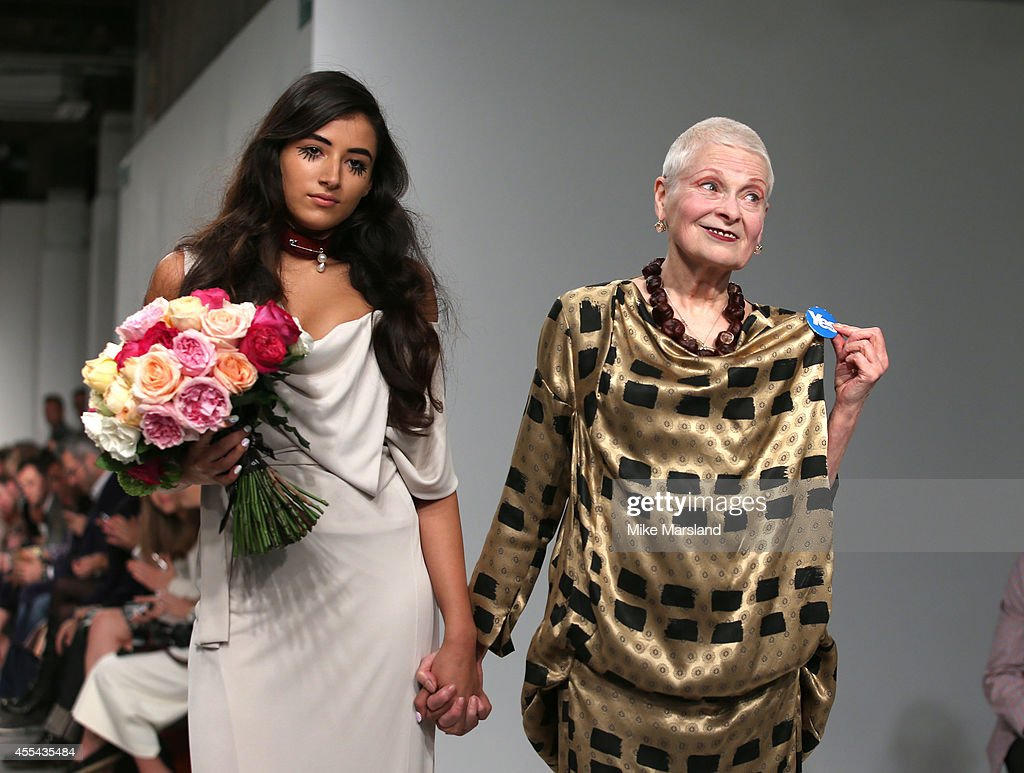 Vivienne Westwood and granddaughter Cora Corre greet the audience following her Vivienne Westwood Red Label show during London Fashion Week Spring...
