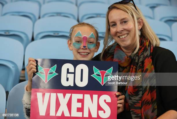 Vixens fan in the crowd with her face painted shows her support during the Super Netball Major Semi Final match between the Vixens and the Lightning...
