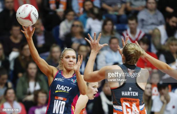 Vixens Kate Moloney passes the ball during the round 12 Super Netball match between the Giants and the Vixens at AIS on May 14 2017 in Canberra...