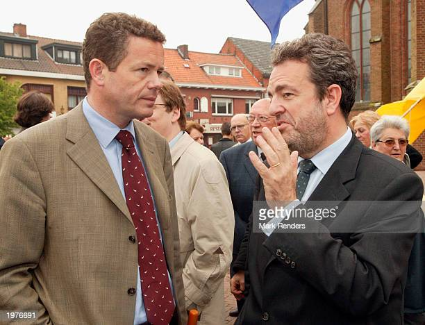 Vlaams Blok Senator Gerolf Annemans and Vlaams Blok Chairman Frank Van Hecke talk during a memorial for Dutch politician Pim Fortuyn May 6 2003 at...