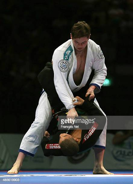 Vlacheslav Ilin of Russia competes against Paulo Costa of Brazil in the Men's blue belt open weight finals during the Abu Dhabi World Professional...