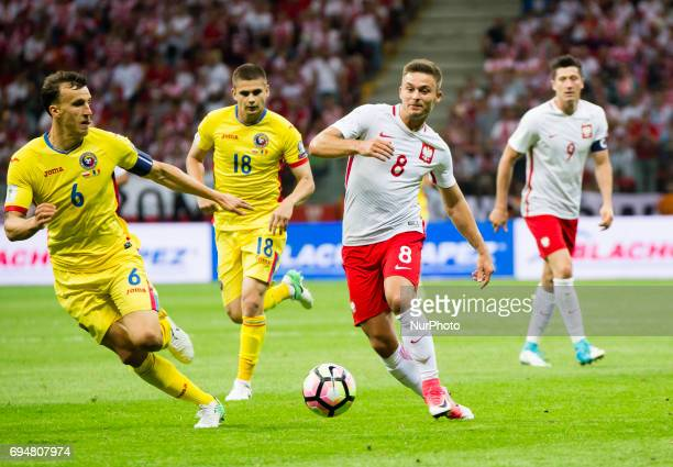 Vlad Chiriches and Karol Linetty during the 2018 World Cup Qualifying Match Poland vs Romania 10 June Warsaw Poland
