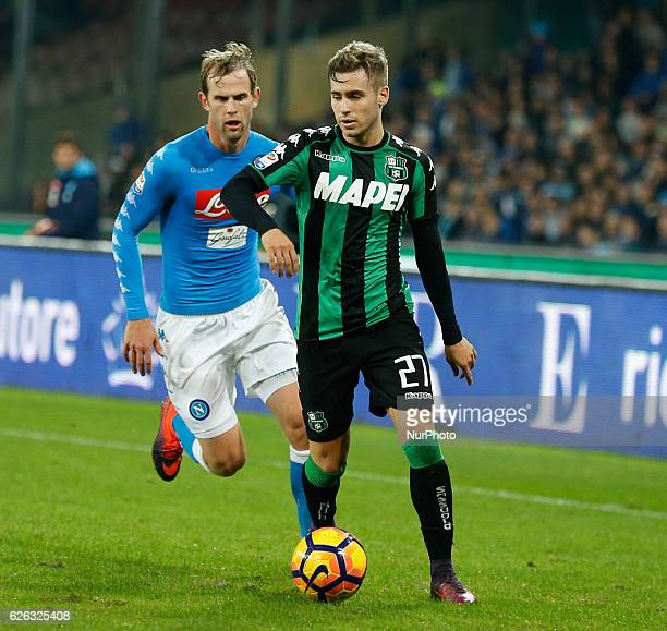 Vlad Chiriches of Naples vies Federico Ricci during the Italian Serie A football match between Napoli and Sassuolo Calcio at the San Paolo Stadium on...