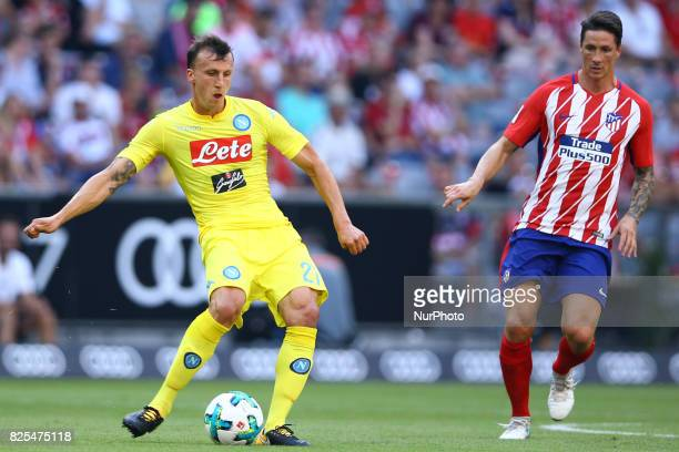 Vlad Chiriches of Napoli and Fernando Torres of Atletico de Madrid during the first Audi Cup football match between Atletico Madrid and SSC Napoli in...