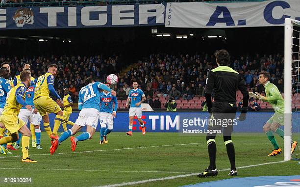 Vlad Chiriches of Napoli scores his team's second goal during the Serie A match between SSC Napoli and AC Chievo Verona at Stadio San Paolo on March...