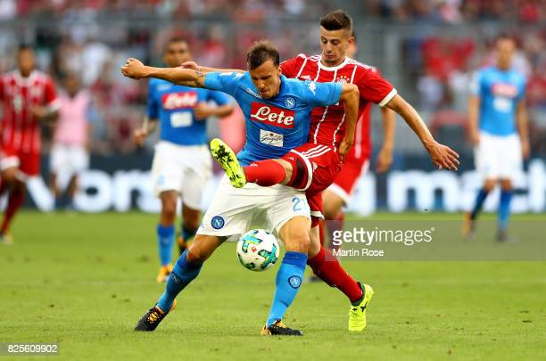 Vlad Chiriches of Napoloi and Mario Crnicki of Muenchen battle for the ball during the Audi Cup 2017 match between SSC Napoli and FC Bayern Muenchen...