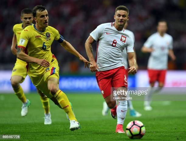 Vlad Chiriches of Romania and Karol Linetty of Poland in action during the 2018 FIFA World Cup Russia eliminations match between Poland and Romania...