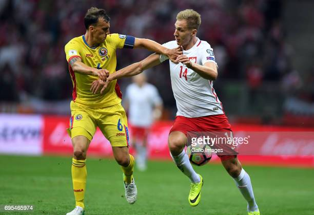 Vlad Chiriches of Romania and Lukasz Teodorczyk of Poland in action during the 2018 FIFA World Cup Russia eliminations match between Poland and...