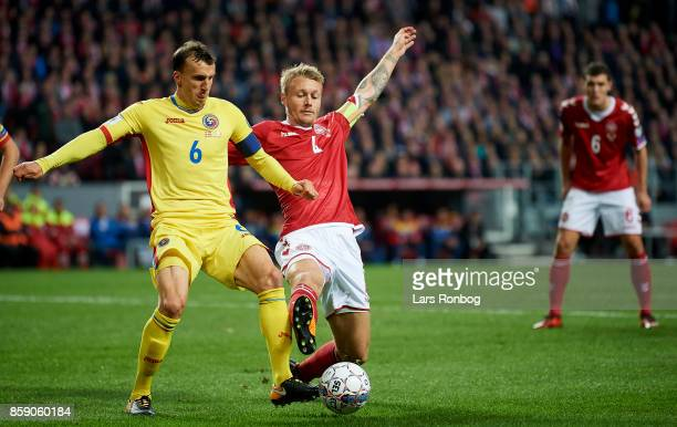 Vlad Chiriches of Romania and Simon Kjar of Denmark compete for the ball during the FIFA World Cup 2018 qualifier match between Denmark and Romania...