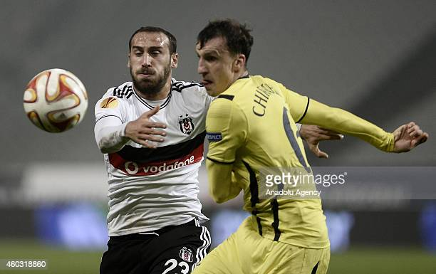 Vlad Chiriches of Tottenham Hotspur vies for the ball with Cenk Tosun of Besiktas during the UEFA Europa League Group C match between Besiktas JK and...